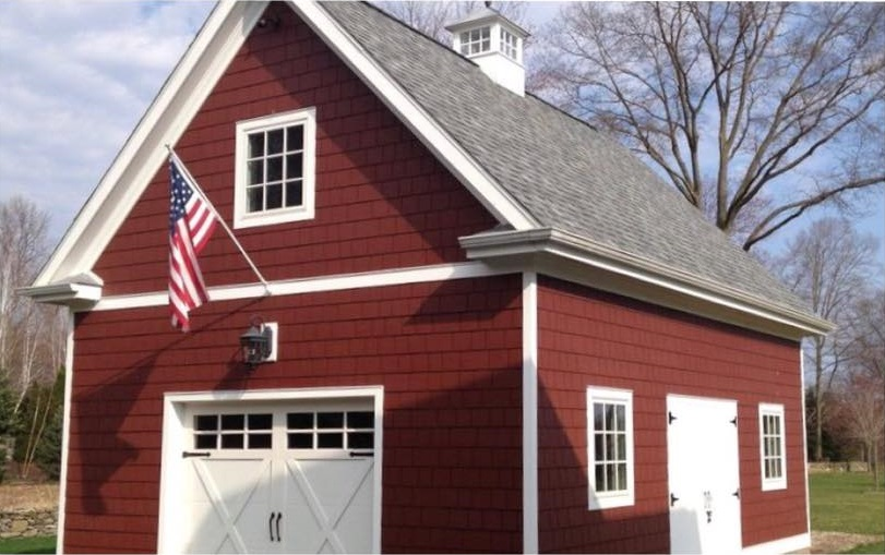 new red shingles on barn