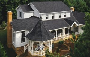 black pearl shingles on white sided house