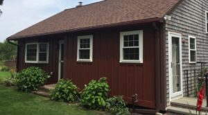 Batten board red siding house