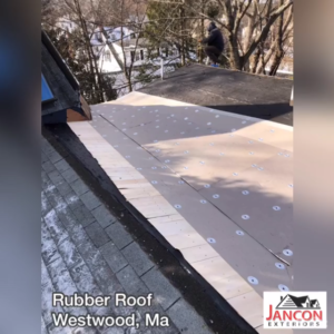 during process of installing rubber roof on house
